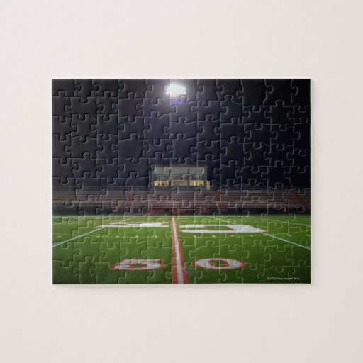 Illuminated American football field at night Puzzles