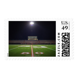 Illuminated American football field at night Stamps