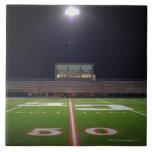Illuminated American football field at night Tile