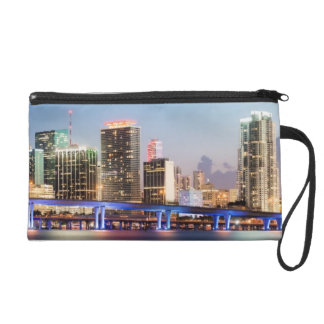 Illuminated skyline of downtown Miami at dusk Wristlet Purse