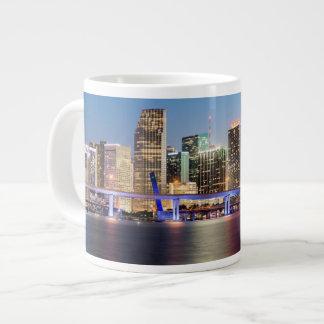 Illuminated skyline of downtown Miami at dusk Giant Coffee Mug