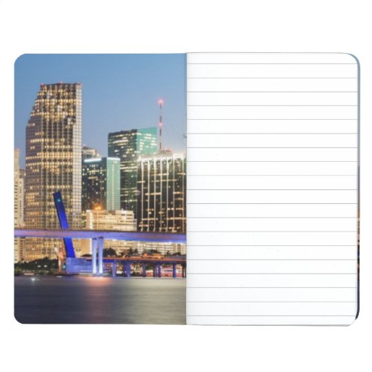 Illuminated skyline of downtown Miami at dusk Journal