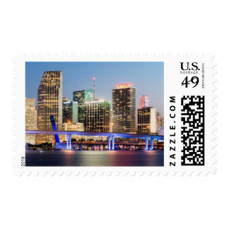 Illuminated skyline of downtown Miami at dusk Stamps