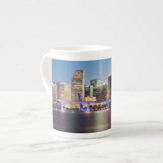 Illuminated skyline of downtown Miami at dusk Tea Cup