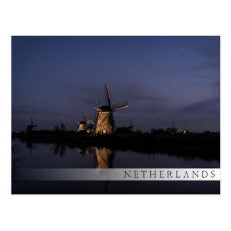 Illuminated windmill at Blue Hour bar postcard