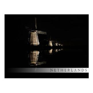 Illuminated windmills at night bar postcard