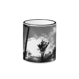 Illumination tower and cloud of tennis court ringer coffee mug