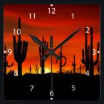 "Illustration of cactus tree when the sunset square wall clock<br><div class=""desc"">desert&#160;, silhouette&#160;, cactus&#160;, landscape&#160;, desert plants&#160;, saguaro cactus&#160;, saguaro&#160;, arizona desert&#160;, desert landscape&#160;, desert cactus&#160;, hot&#160;, southwest&#160;, red&#160;, beautiful&#160;, mexico&#160;, sunrise&#160;, sun&#160;, sunset&#160;, art&#160;, vintage&#160;, summer&#160;, american&#160;, arizona&#160;, color&#160;, clouds&#160;, mountain&#160;, west&#160;, flora&#160;, natural&#160;, sand&#160;, western&#160;, mountains&#160;, mexican&#160;, illustration&#160;, cacti&#160;, colorful&#160;, vegetation&#160;, arizona cactus&#160;, saguaros&#160;, landscape desert&#160;, </div>"