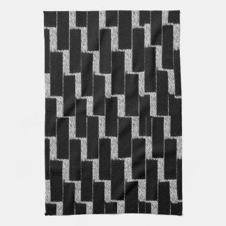 Ilusión de plata y negra toalla