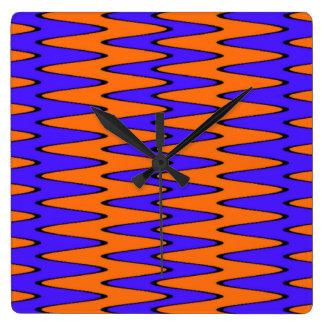 Ilusión óptica azul y anaranjada reloj cuadrado