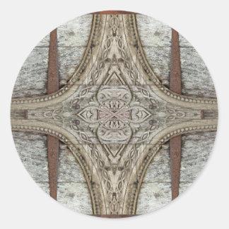 Ilustraciones del ornamento de madera y del hierro pegatina redonda