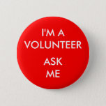 "I&#39;m A Volunteer Ask Me Red Badge Event Button<br><div class=""desc"">I&#39;m A Volunteer Ask Me Red Badge Event Button. Bright Red background with white letters - attention getting. Use at any charity, business show, special event, or trade show for your hostesses or volunteers, or for those manning an information desk. Available in different sizes, and shapes and background colors. Or...</div>"