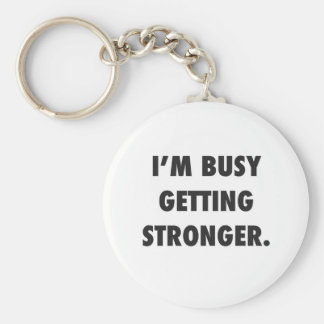 I'M BUSY GETTING STRONGER CHARACTER MOTIVATIONAL E BASIC ROUND BUTTON KEYCHAIN