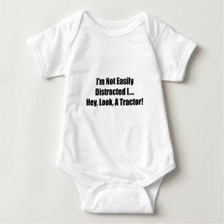 Im Not Easily Distracted I Hey Look A  Tractor Baby Bodysuit