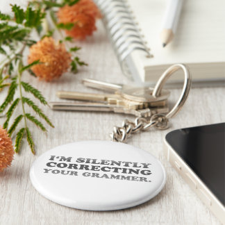 I'm silently correcting your grammar basic round button keychain