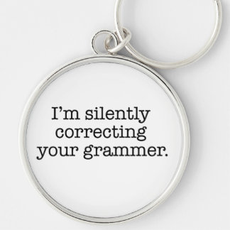 I'm silently correcting your grammer. Silver-Colored round keychain