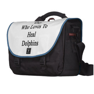I'm That Crazy Guy Who Loves To Heal Dolphins Bags For Laptop