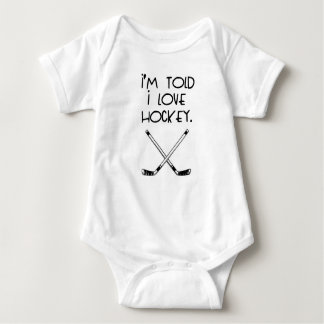I'm Told I Love Hockey Baby Bodysuit