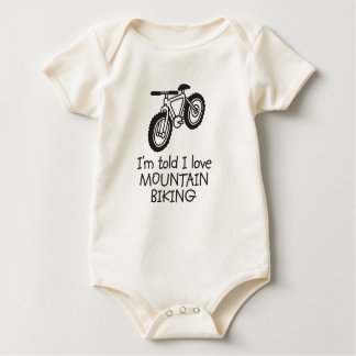 I'm told I love MOUNTAIN BIKING Baby Bodysuit