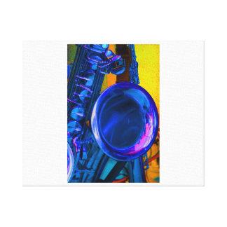 Imagen azul del saxofón con del amarillo la parte  lona envuelta para galerías