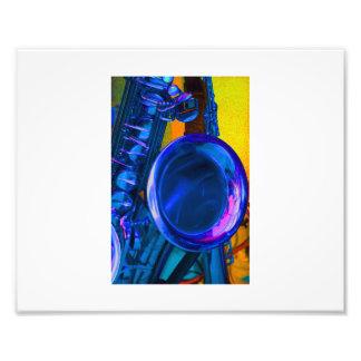 Imagen azul del saxofón con del amarillo la parte impresion fotografica