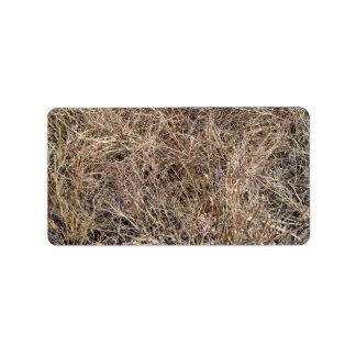 Imagen de fondo de palillos y de hojas secos etiqueta de dirección