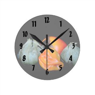 imagen de la legumbre de fruta del caqui de la reloj redondo mediano