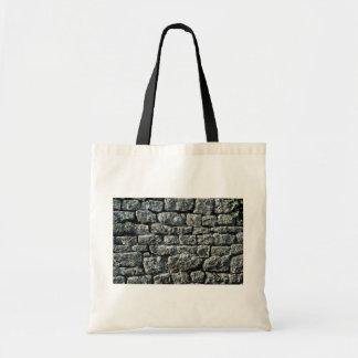 Imagen de la textura de la pared de piedra bolsa de mano