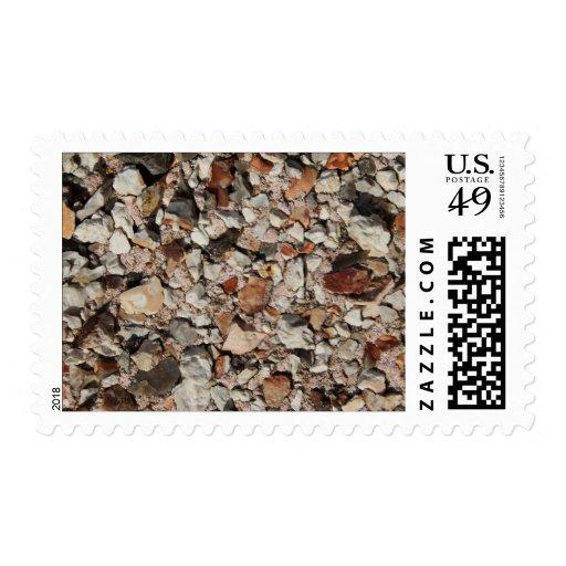 Imagen de piedras en una pared sellos postales