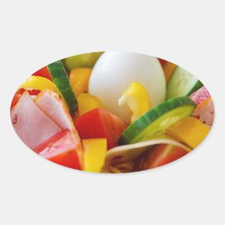 Imagen deliciosa de la comida de la ensalada de pegatina ovalada