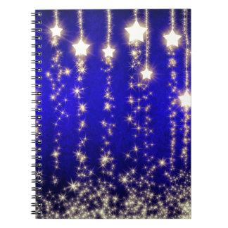 Imagen magnífica de la noche de la estrella del na libreta espiral