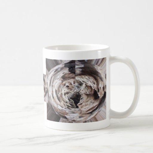 Imagen marrón gris del diseño del caleidoscopio taza