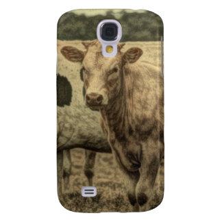 Imagen rústica de la vaca en campo