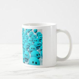 Imagen sonriente de la diversión de la cara taza de café