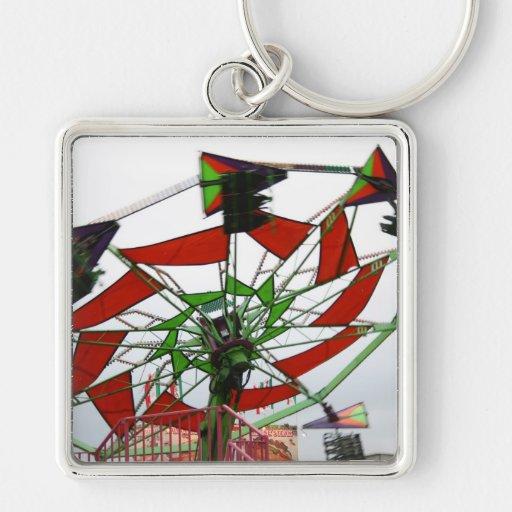 Imagen verde y roja del paseo del planeador justo  llavero personalizado