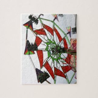 Imagen verde y roja del paseo del planeador justo puzzles con fotos