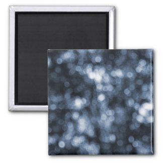 Imán azul abstracto de Bokeh