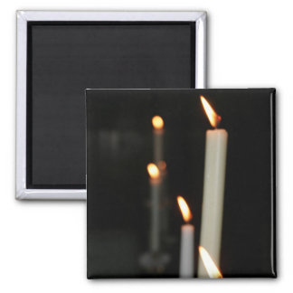 Imán con la iluminación de velas
