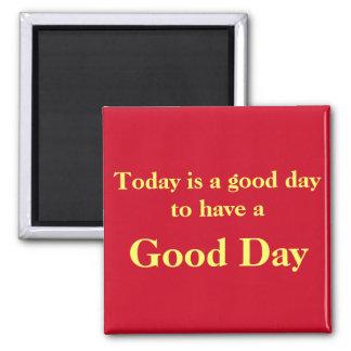 Imán del rojo del buen día
