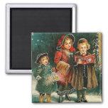 Imán del vintage de los Carolers del navidad