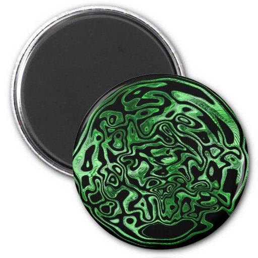 Imán metálico verde derretido