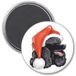 Imán negro del caniche del navidad