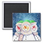 Imán sonriente de tres muñecos de nieve