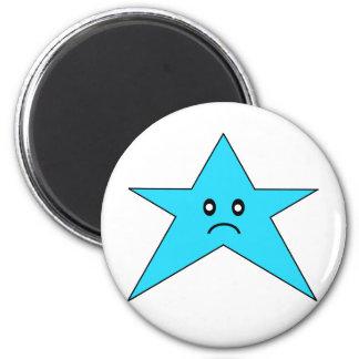 Imán triste azul del refrigerador de la estrella