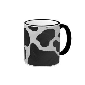 Impresión blanco y negro de la vaca taza de dos colores