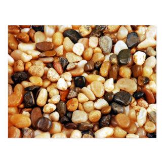 Impresión brillante de los guijarros de la playa d postal