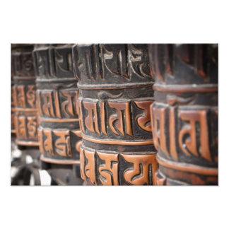 Impresión budista de la foto de las ruedas de rezo fotografías