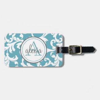 Impresión con monograma del damasco del azul de etiquetas maleta