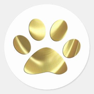 Impresión de la pata del gato del oro pegatina redonda