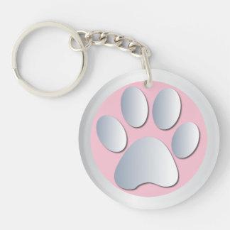 Impresión de la pata del perro en de plata y rosad llaveros